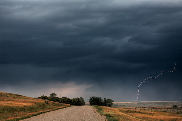 Storm Clouds And Lightning Along A Saskatchewan Country Road Print by Mark Duffy