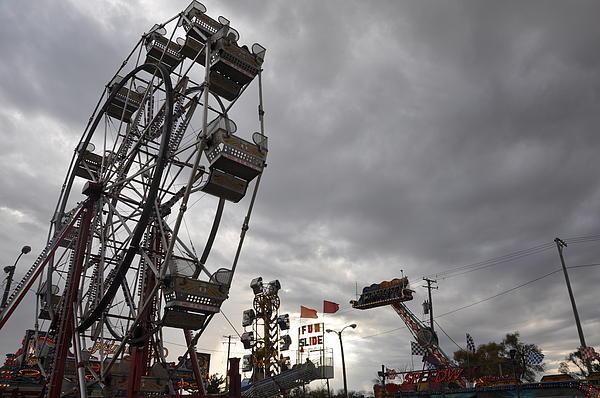 Stormy Ferris Wheel Print by Daniel Ness