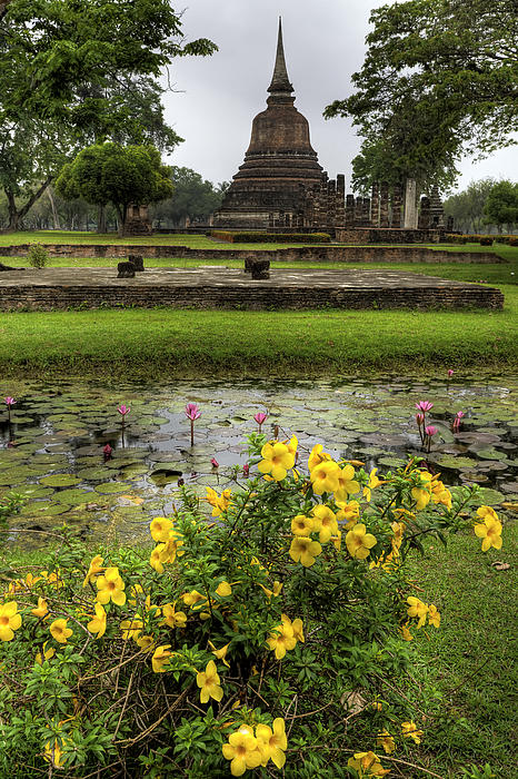 Sukhothai Historical Park Print by Adrian Evans
