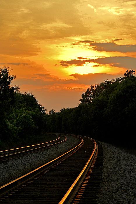 Sun Reflecting On Tracks Print by Benanne Stiens