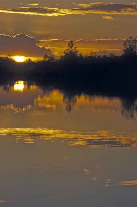 Sunset On A Lake Print by Patrick Kessler