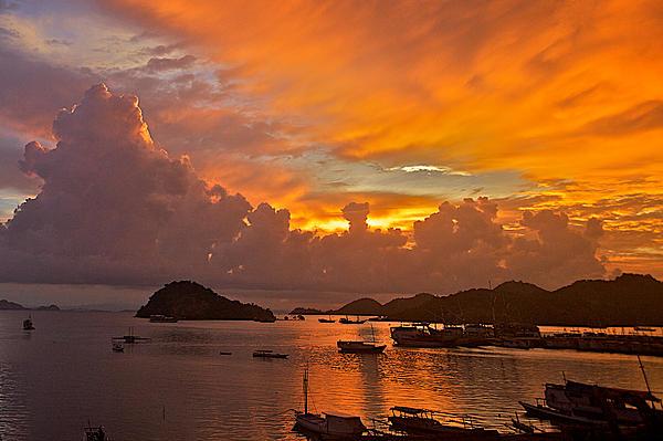 Sunset Over Lubuan Bajo Print by Raymond Uzanas