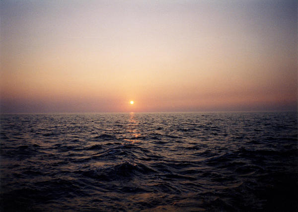 Sunset Over The Ocean Print by Thomas Luca