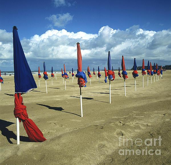 Sunshade On The Beach. Deauville. Normandy Print by Bernard Jaubert