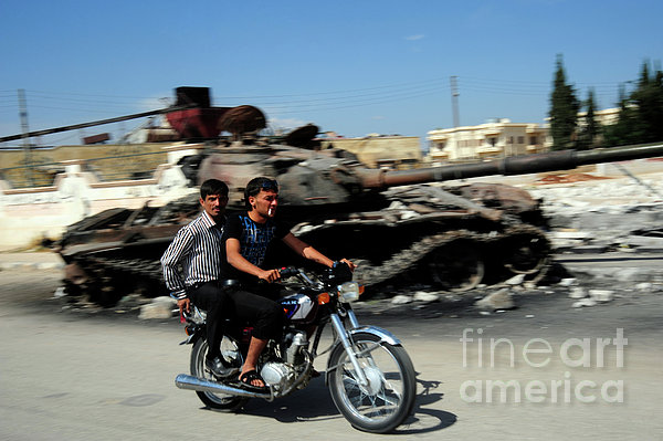 Syrian Men Drive A Motorbike Print by Andrew Chittock