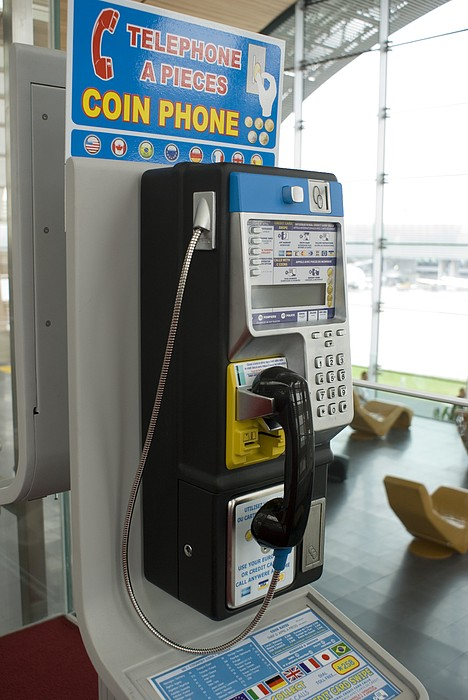 Telephone In Airport Lounge Print by Mark Williamson