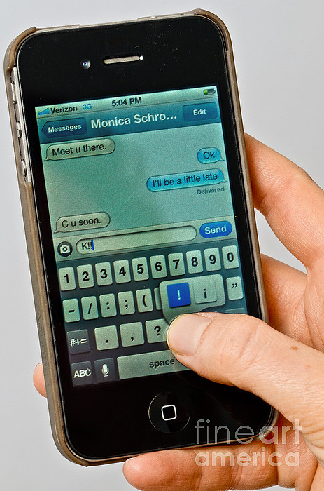 Texting On An Iphone Print by Photo Researchers