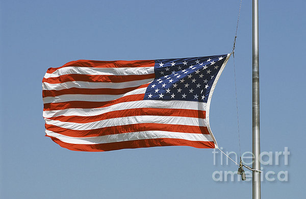 The American Flag Waves At Half-mast Print by Stocktrek Images