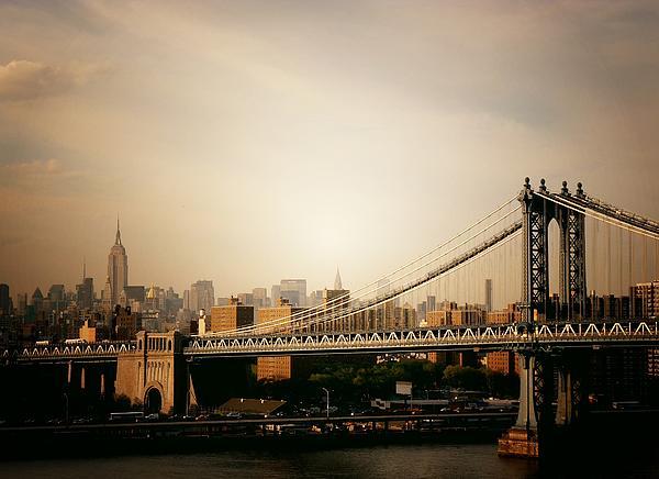 The New York City Skyline And Manhattan Bridge At Sunset Print by Vivienne Gucwa