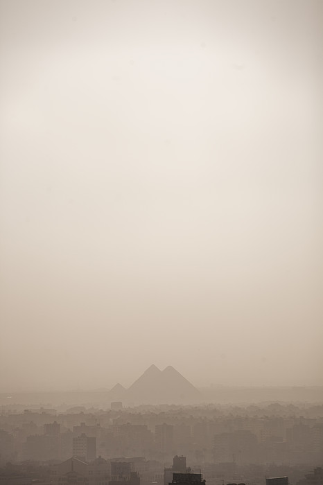 The Pyramids Rise Over The Smog Print by Taylor S. Kennedy