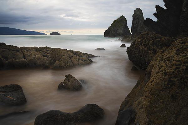 The Rocks Of Laga Beach Print by Fernando Alvarez