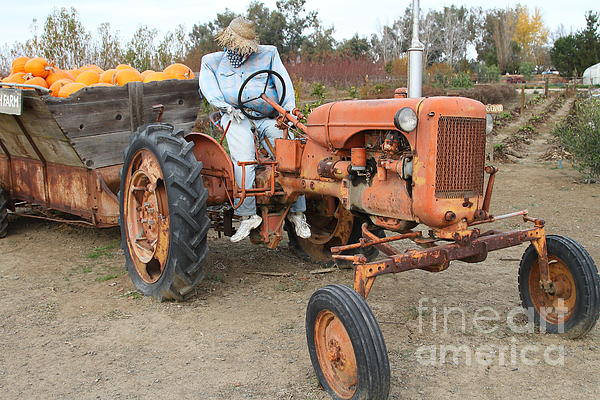 The Scarecrow Riding On The Old Farm Tractor . 7d10300 Print by Wingsdomain Art and Photography