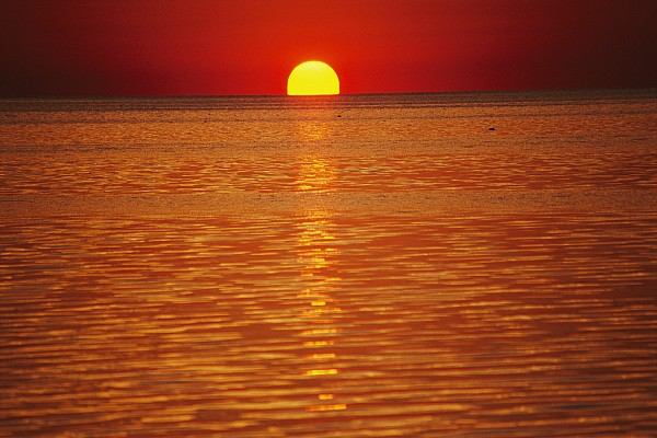 The Sun Sinks Into Pamlico Sound Seen Print by Stephen St. John