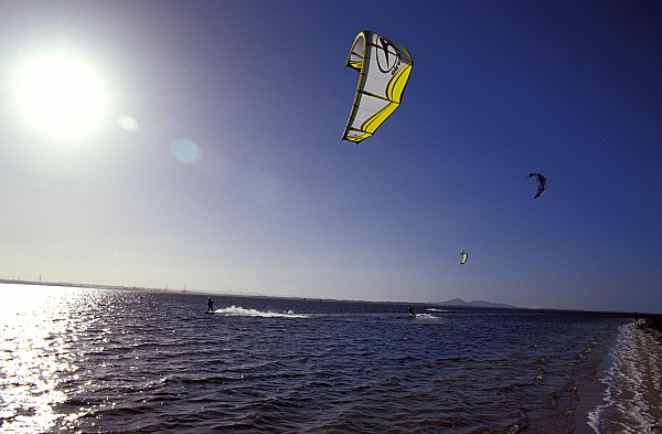 Three Kite Surfers On A Windy Summer Print by Jason Edwards