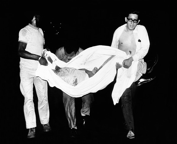 Three Men Carry Body Of A Youth Who Print by Everett