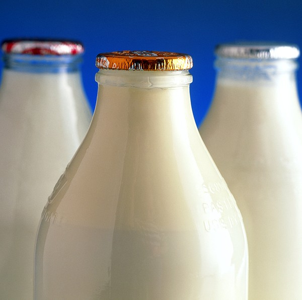 Tops Of Three Types Of Bottled Milk Print by Steve Horrell