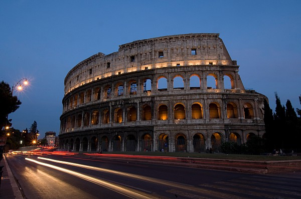 Traffic Goes By The Colosseum At Night Print by Joel Sartore