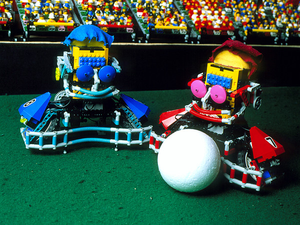 Two Lego Footballers With A Ball At Robocup-98 Print by Volker Steger