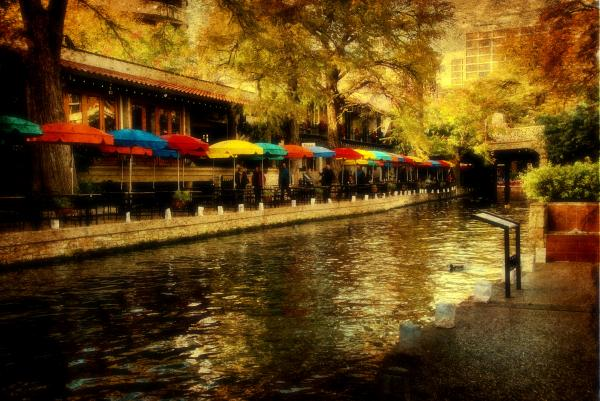 Umbrellas In The Riverwalk Print by Iris Greenwell