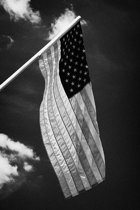 Us American Flag On Flagpole Against Blue Cloudy Sky Usa Print by Joe Fox