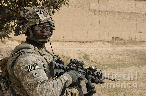 U.s. Army Soldier Scans His Area While Print by Stocktrek Images