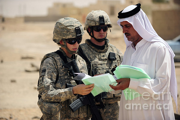 U.s. Army Soldiers Talking With A Town Print by Stocktrek Images