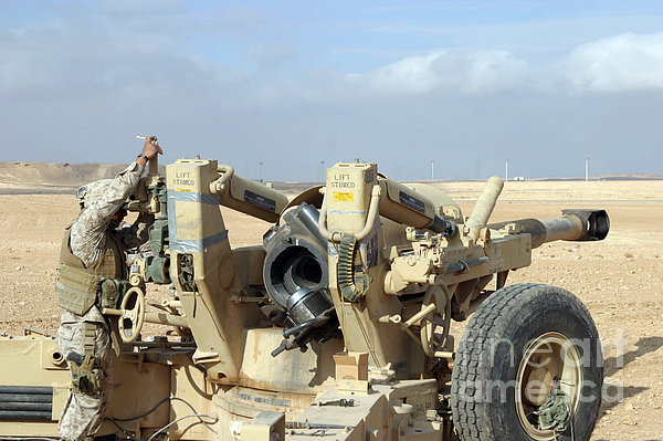 U.s. Marines Prepare To Fire A Howitzer Print by Stocktrek Images