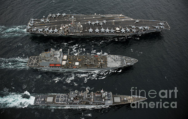 U.s. Navy Ships Conduct A Replenishment Print by Stocktrek Images