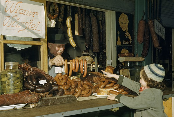Vendor Holds Up Sausages For Young Girl Print by Volkmar Wentzel