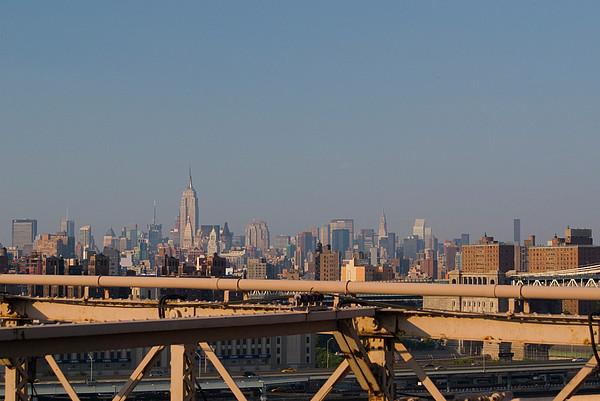 View Over New York City From Brooklyn Bridge Print by Thepurpledoor