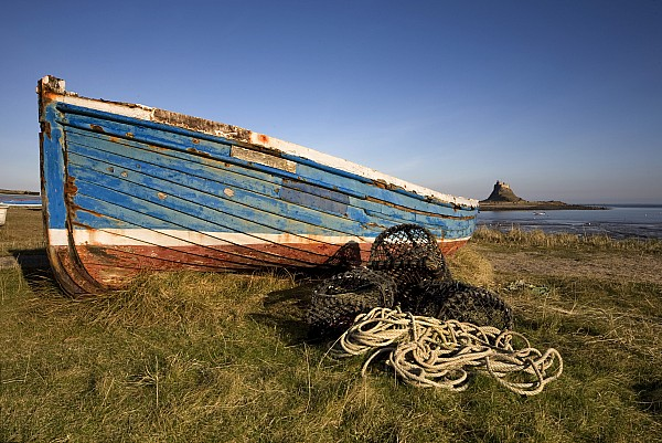 Weathered Fishing Boat On Shore, Holy Print by John Short