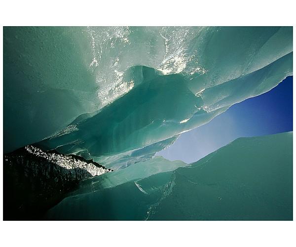 Wolf Creek Flows Through Perennial Ice Print by Raymond Gehman