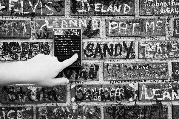 Womans Hand Pushing Old Intercom Button On Wall Covered In Graffiti Outside Graceland Memphis Print by Joe Fox