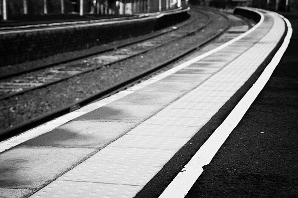 Yellow Warning Line And Textured Contoured Tiles Railway Station Platform And Track Northern Ireland Print by Joe Fox