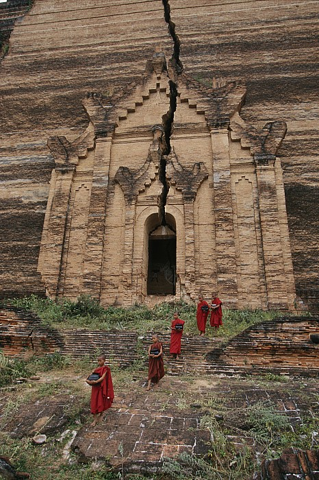 Young Buddhist Monks Near A Ruined Print by Paul Chesley