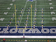 Nfl Raiders Pictures Posters -  The Dallas Cowboys Cheerleaders Halftime Show Poster by Donna Wilson