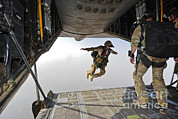 Featured Acrylic Prints - A U.s. Air Force Pararescueman Jumps Acrylic Print by Stocktrek Images