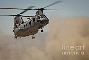 Cloud Dust Posters - A U.s. Marine Corps Ch-46e Sea Knight Poster by Stocktrek Images