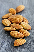 Roasted Photo Acrylic Prints - Almonds Acrylic Print by Elena Elisseeva