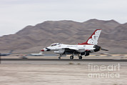 On The Runway Photos - An F-16c Thunderbird Sits On The Runway by Terry Moore
