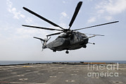 Sea Platform Posters - An Mh-53e Sea Dragon Prepares To Land Poster by Stocktrek Images