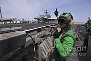 Uss Enterprise Prints - Aviation Boatswain's Mate Signals Print by Stocktrek Images