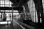 Berlin Germany Prints - Berlin S-Bahn train speeds past platform at Alexanderplatz main train station Germany Print by Joe Fox