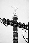 Berlin Germany Framed Prints - Berlin Victory Column Siegessaule behind roadsign for Strasse des 17 Juni Berlin Germany Framed Print by Joe Fox