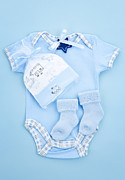 Kid Photo Posters - Blue baby clothes for infant boy Poster by Elena Elisseeva