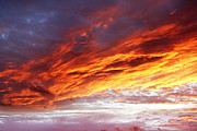 Sky Fire Prints - Bright sunset sky  Print by Les Cunliffe