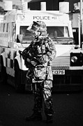Unrest Framed Prints - British Army soldier with MP5 on crumlin road at ardoyne shops belfast 12th July Framed Print by Joe Fox