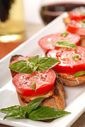 Olive Snacks Framed Prints - Bruschetta topped with fresh tomato and basil Framed Print by David Smith
