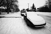 Winter Roads Posters - car covered in snow parked on street in pleasant hill Saskatoon Saskatchewan Canada Poster by Joe Fox