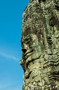 Siem Reap Posters - Carved face at Bayon Temple Angkor Cambodia Poster by Fototrav Print
